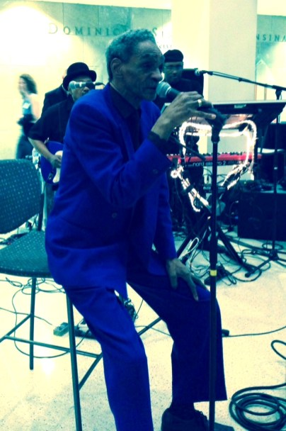 Howard Scott sings with his family band. The symposium honored the Scotts: five generations of blues, R&B, soul musicians from Chicago's South Side.