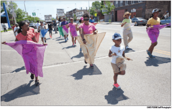 The Kingdom Builders Dance Army, including its youngest member, Derrianna Brandon, 6, marched down Chicago Avenue in the Juneteenth Parade June 14th. The parade ran from Cicero Avenue to Mayfield.