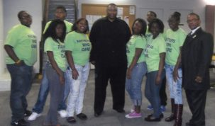 Alderman Ervin and Reverend Jones with the youth helped by Fathers Who Care, a local nonprofit.