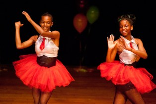 Chartise Courtney, left, and Destiny Reed exit the stage after a duet. (David Pierini/staff photographer)