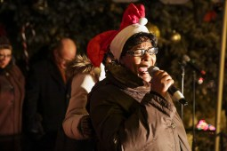 Ald. Emma Mitts (29th) gives a prayer just before the annual tree lighting, outside the 15th District Police Station, on Thursday, December 4, 2014. | Chandler West/Staff Photographer