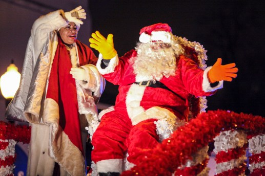 Santa and Mrs. Clause wave to onlookers as the parade marches down Madison Street on Thursday, December 4, 2014. | Chandler West/Staff Photographer