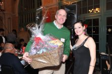 Host Alicia Plomin with Bill Planek of Oak Park Apartments, after winning the Teen Girl raffle basket full of gifts for his daughters