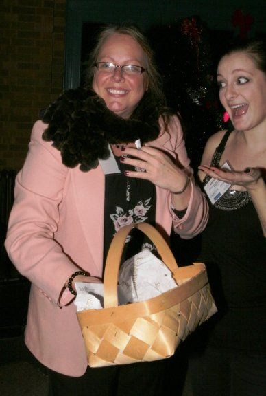 A guest tries on her prize: a mink fur scarf worth 00 from York Furrier