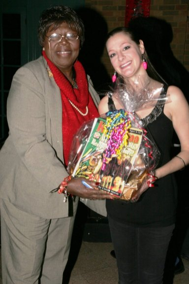 Dr. Louverta Hurt poses with her prize: A Kwanzaa Basket that includes a one-year membership, donated by the DuSable Museum of African-American History
