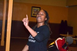 """Artist and host Awthentik performs her poetry piece """"Redemption"""" Sunday. (Nicholas Samuel/Contributor)"""