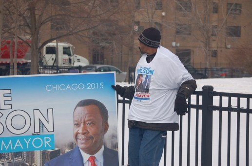 A Willie Wilson campaign worker sets up before a noon press conference today, Jan. 16, in front of the Austin Town Hall building.