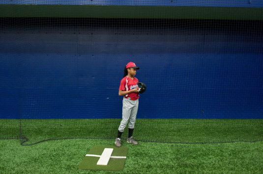 Zanaiyha Taylor 12, of the Garfield Park little league team gets ready to practice her pitching at an indoor baseball field located at UIC on February 14. (William Camargo/Contributor)