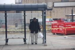 A CTA passenger waits for the bus inside the shelter facing Austin Boulevard. Michael Romain/Staff.