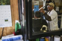 Herb Harrington, above, clips a client's hair at Herb's Barber Shop, 5118 W Chicago Ave., last Friday. (Chandler West/Staff Photographer)