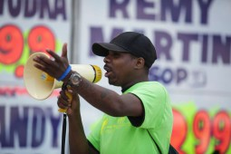 David Elam, 25, a member of West Garfield Community Stakeholders, rallies against underage drinking outside Personal Liquors, on Saturday, April 18, 2015. The group says Personal Liquors, 4241 West Madison St, is a positive example of proper business practices. | CHANDLER WEST/Staff Photographer