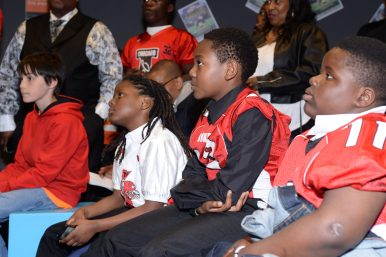 Members of the Chicago Jokers youth football team gathered at Columbia College Chicago downtown to listen to University of Wisconsin running back Melvin Gordon. Gordon would eventually be selected 15th by the San Diego Chargers.(Photo by Bob Mead/Mead Communications)