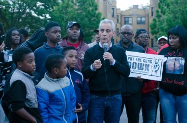 Mayor Rahm Emanuel reinforced themes of mentorship and community from his inaugural speech during the May 22 Summer of Faith and Action on the parking lot of Friendship Baptist Church, 5200 W. Jackson Blvd. Friendship's pastor, Rev. Reginald Bachus (left), and Pastor Robbie Wilkerson look on as the mayor speaks. | TANYA HARRIS/Contributor