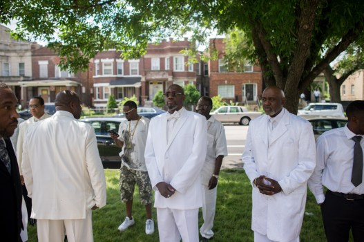 Fathers in the west side of Chicago, were blessed and given prayers to during services on Father's Day on June 21, 2015 at Corinthian Temple Church of God in Christ. | WILLIAM CAMARGO/Staff Photographer
