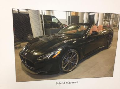 A picture of a seized 2014 Maserati during a June 24 press conference announcing the results of Operation G.I. Joe. Local and Federal law enforcement officials arrested 32 alleged drug-dealers in what may be one of the largest stings to take place in North Lawndale in a generation. Michael Romain/Staff.