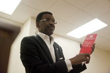 Rev. Michael Eaddy pictured on Tue. July 14, 2015, at the launch of his Preservation of Life Campaign, a faith-based initiative designed to blanket the city with red door knob hangers to deter the 'death angel' of gun violence. William Camargo/Staff.