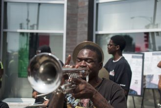 STATUE UNVEILING: Tremble Neloms plays him trumpet , during the one year celebration of Mandela Road, a campaign speared by representative LaShawn Ford and other members of the community. The celebration took place at the West Side Health Authority in the corner of Chicago Ave and Cicero now know as Mandela road on July 18. | WILLIAM CAMARGO/Staff Photographer