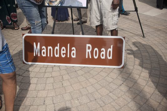 The road sign for Mandela road, during a celebration in Austin for the one year anniversary of Mandela Road. Music, traditional african dances and music was displayed on full effect on the corner of Chicago and Cicero now know as Mandela Road on July 18. | WILLIAM CAMARGO/Staff Photographer