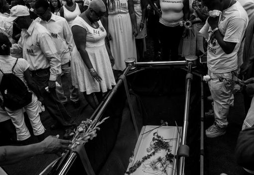 DEATH OF AN ACTIVIST: Friends and family carry the casket at a Willow Springs, as mourners gather to say their last goodbye to Sandra Bland on Saturday July 25. Shante Needham, the older sister of Sandra Bland, and other mourners dressed in all white give the last goodbye to Sandra at a Willow Springs grave site on Saturday July 15, 2015, as she is lowered into the ground. | William Camargo/Staff Photographer