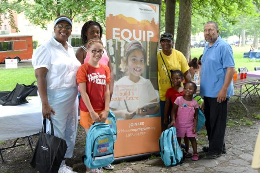 Ruth Kimble of the Austin Childcare Providers Network (in yellow) handing out back packs of school supplies provided by World Vision