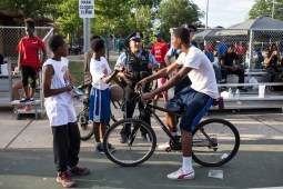 Officer Cuevas of the 15th district talks with community members at Moore Park, where National Night Out took place on Tuesday, August 4, 2015. | Alex Wroblewski/Contributor.