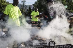 Williams and Green, below left, work the grill. | Alex Wroblewski/Contributor