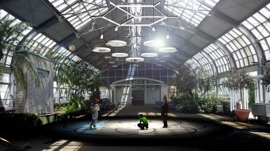 Workers installing solaris, the sculpture that will be exhibited, along with a light installation, at Garfield Park Conservatory starting in September. Garfield Park Conservatory.