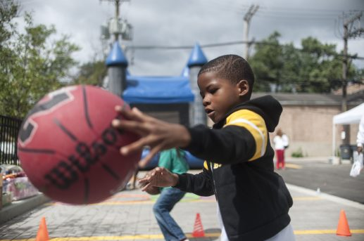 Pierre Stewart, 6, shows off his dribbling skills during the August 20 ribbon-cutting. Middle: Children play during the festivities. | WILLIAM CAMARGO/Staff Photographer