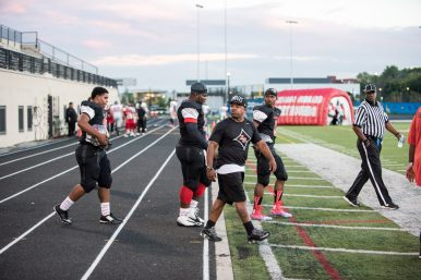 Al Raby head football coach D'Angelo Dereef leads his team onto the field during a game Thursday, Sept. 10, 2015, against Hubbard at Lane Stadium, 2601 W Addison St. on the North Side. | Max Herman/Contributor.