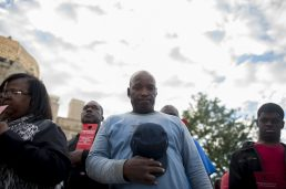 Community leaders and residents gather in front of the Garfield Park field house on Thurs., September 10, 2015, for a prayer vigil on behalf of the toddler that was found in the Garfield Park Lagoon over Labor Day weekend.   William Camargo/Staff.