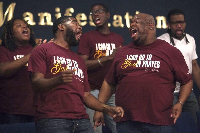 Members of New St. Matthews Church Chorale sing during a recent Sunday morning service at the church, 5530 W. Harrison. The choir took 2nd place at this year's Ford Neighborhood Awards, which is sponsored by the Steve Harvey Show and State Farm Insurance. | Michelle Kanaar/Contributor.