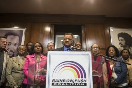 Rev. Jesse Jackson, with community leaders and elected officials, during a press conference Monday, Oct. 5, 2015, at his Rainbow/Push headquarters on the South Side. The leaders are calling for President Obama to convene a White House conference on gun violence in the city. | William Camargo/Wednesday Journal.