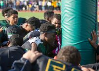 Westinghouse Warriors players huddle together in prayer after the team's 22-8 homecoming victory over the Eagles Saturday, Oct. 10, 2015. | Jennifer Lacy/Contributor.
