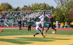 Westinghouse Warriors and Michele Clark Eagles players fight over a pass during the Warriors' 22-8 homecoming victory over the Eagles Saturday, Oct. 10, 2015. | Jennifer Lacy/Contributor.