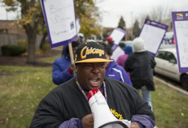 A member of SEIU Healthcare yells into a bullhorn during a protest outside of the Jackson Square Nursing Center in Austin on Nov. 12. Workers at the facility have joined service workers across the city and country in demanding for a 5 minimum wage. | William Camargo/Staff.