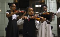 Jacob, one of the youngest members of the Kelly Family Orchestra, plays his violin alongside relatives.? The ensemble performed at Austin Multiplex on Nov. 18, during a night of classical music that also featured the Symphony of Oak Park and River Forest. -The event was free and open to the public.