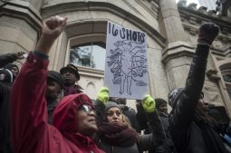 Protesters line the steps of the historic Water Tower during the Nov. 27 Laquan McDonald Black Friday demonstration on the Magnificent Mile. The march, which drew at least 2,500 people, was led by Rev. Jesse Jackson and other activists, elected officials and community leaders. On Nov. 24, police released video showing McDonald getting shot 16 times by Chicago police officer Jason Van Dyke last October. | William Camargo/Staff.