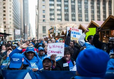 Protesters demand for Mayor Rahm Emanuel's resignation during a Dec. 9 demonstration outside of the Daley Plaza in downtown Chicago. | William Camargo/Staff.