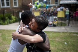 Elizabeth Ramirez, whose son was killed nearly four years ago, hugs Antonio Brown on July 6. Brown is the father of Amari Brown, 7, who was gunned down on the Fourth of July weekend. | WILLIAM CAMARGO/Staff Photographer