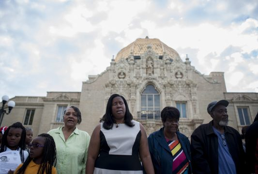 People gathered in front of the Garfield Park Fieldhouse on Sep. 10 during a vigil for a missing child whose body parts were found in Garfield Park Lagoon. | WILLIAM CAMARGO/Staff Photographer