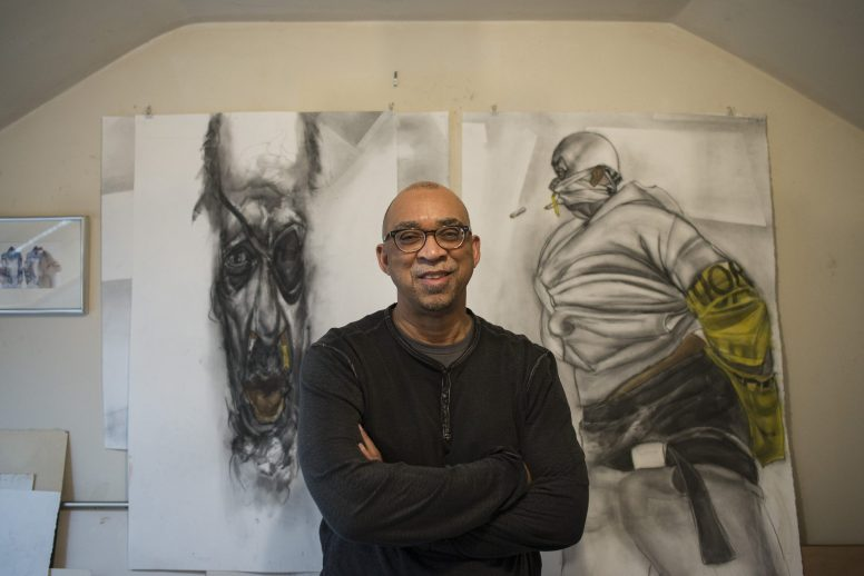 Jesse Howard in his home studio in Maywood. Howard, a West Side native, says his old neighborhood informs much of his work and life. | William Camargo/Staff.