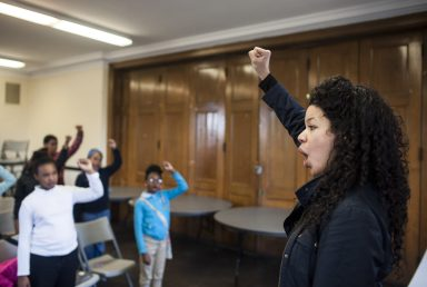 Keshena Cisneros-Watson directs members of the Chicago Children's Choir's Austin neighborhood choir during a March 16 rehearsal at Austin Town Hall.