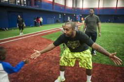 Coach Jermaine Harris of the Garfield Park Little League teaches running techniques during an April 15 practice at Curtis Granderson Stadium on the Near West Side. | William Camargo/Staff.