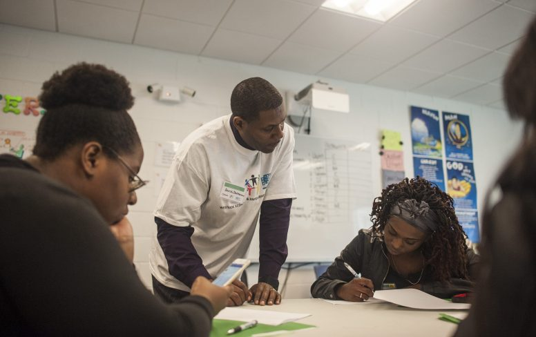 Darryl Jefferson assists West Side youths with writing resumes during an April 21 empowerment conference hosted by the Westside Health Authority and held at By the Hand Club in Austin. | William Camargo/Staff