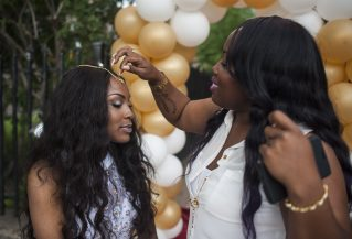 Kandyn Hatley, 18, gets glammed up by her aunt, Shonda Lemon, 29, in front of their Central Ave. residence. | William Camargo/Staff
