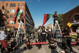 Protesters chain themselves together and block the entrance of the controversial Homan Square detainment facility in North Lawndale during a July 20 demonstration that resulted in at least 10 arrests. The protesters have vowed to camp outside of the facility until the 'Blue Lives Matter' slogan is scrapped. | Sarah Ji/Contributor