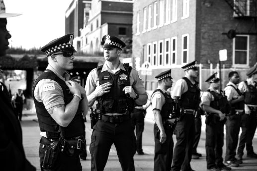 Chicago police officers outside of the Homan Square detention center in North Lawndale during a July 20 demonstration. | Sarah Ji/Contributor