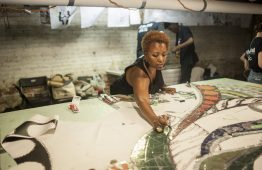 Carolyn Elaine, the lead artist for the mural to be installed under the viaduct at Austin Boulevard and Lake Street, works on the project in the basement of an Austin apartment building before it goes up in a few weeks. | William Camargo/Staff