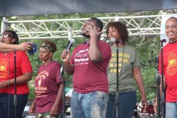 In addition to free haircuts, the Aug. 13 Austin Community Fest also featured numerous musical guests, free food and lots of fun. Rev. Ira Acree, Greater St. John's pastor, touted the power of education in bettering the neighborhood. | Courtesy Greater St. John Bible Church