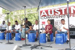 In addition to free haircuts, the Aug. 13 Austin Community Fest also featured numerous musical guests, free food and lots of fun. Rev. Ira Acree, Greater St. John's pastor, touted the power of education in bettering the neighborhood.   Courtesy Greater St. John Bible Church